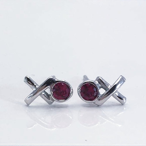 Close up of Silver Kiss Hug Studs with Rubies