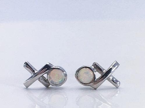 Close up Silver Opal Kiss Hug studs