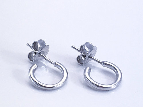Close up of silver Huggi hoops
