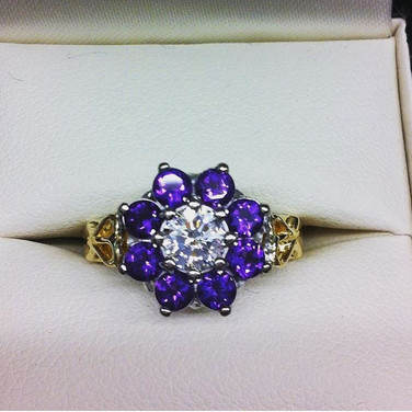 Engagement ring with initial detail on shoulders