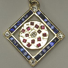 Diamond, Sapphire, Ruby pendant in 18ct yellow gold.