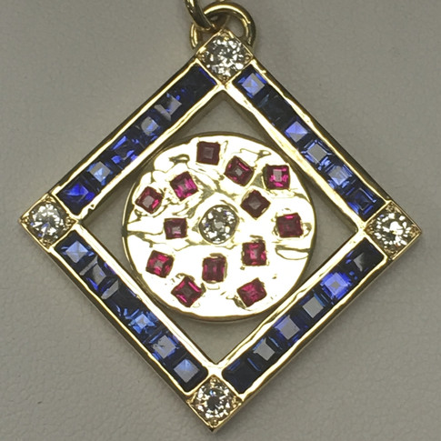 Diamond, Sapphire, Ruby pendant in 18ct yellow gold.