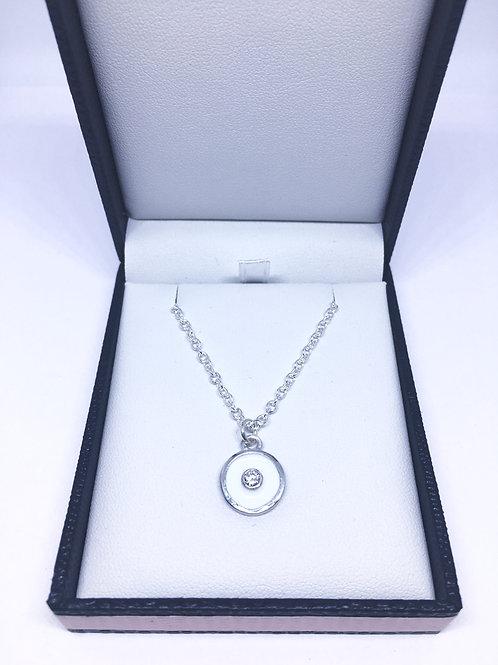 Silver birthstone pendant with white enamel & a white diamond