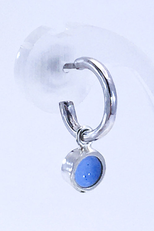 Close up of enamelled lupin blue dot interchangeable earring charm