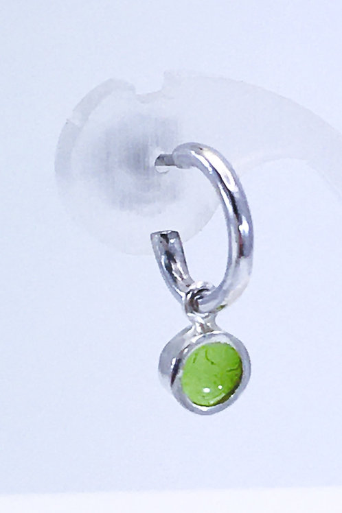 Close up of lime green enamelled dot earring charm
