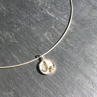 Initial pendant with 18ct yellow gold detail