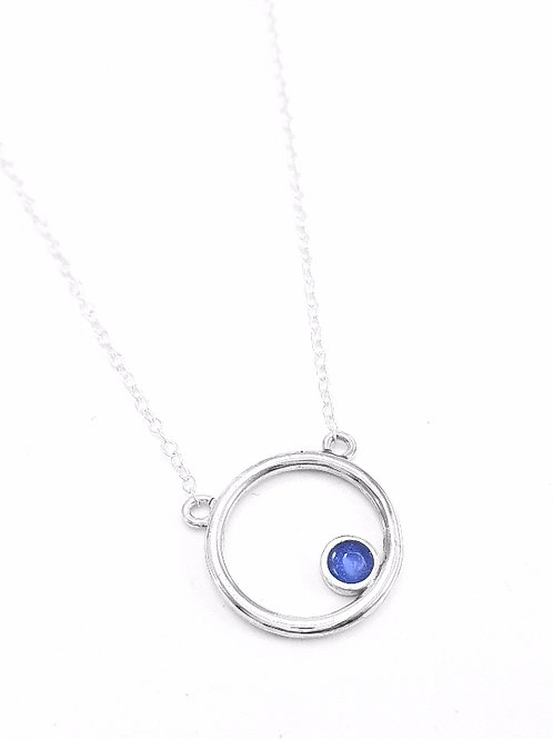 Silver Encircled pendant with transparent sapphire blue
