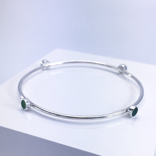Silver Encircled bangle with green enamel dots