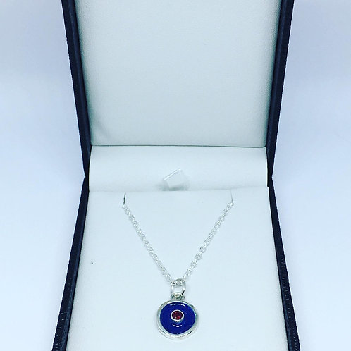 Silver birthstone pendant with windsor blue enamel and a ruby