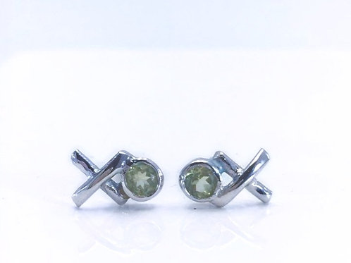 Close up of Silver Peridot Kiss Hug studs