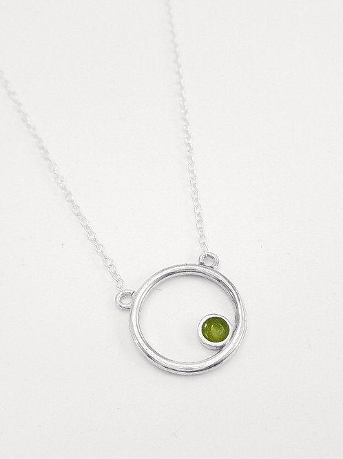 Silver Encircled pendant with transparent olive green