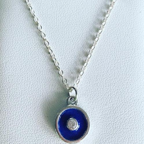 Silver birthstone pendant with dark blue enamel & a white diamond