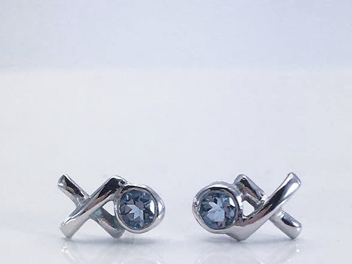 Close up of Boxed Silver Kiss Hug studs with Aquamarines