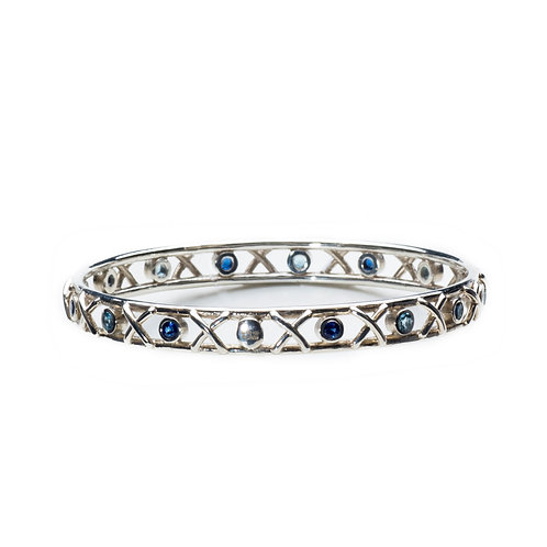 Front view of Silver Kiss Hug bangle set with aquamarines and blue sapphires