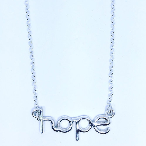 Silver hope pendant on trace chain