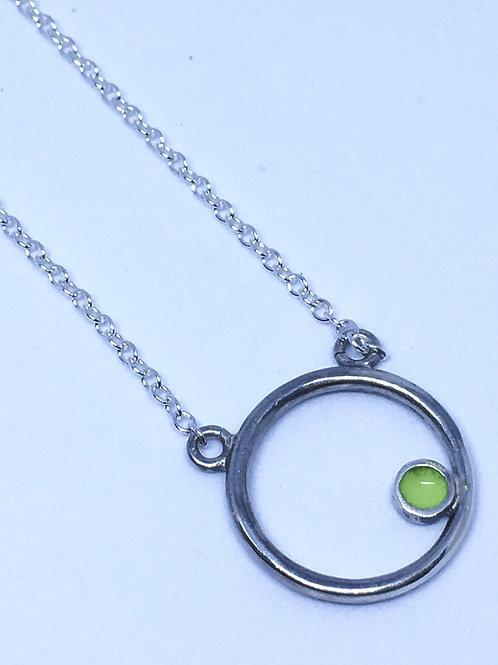Silver encircled pendant with lime green enamel dot
