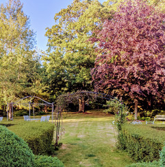 Colourful garden with different seating areas