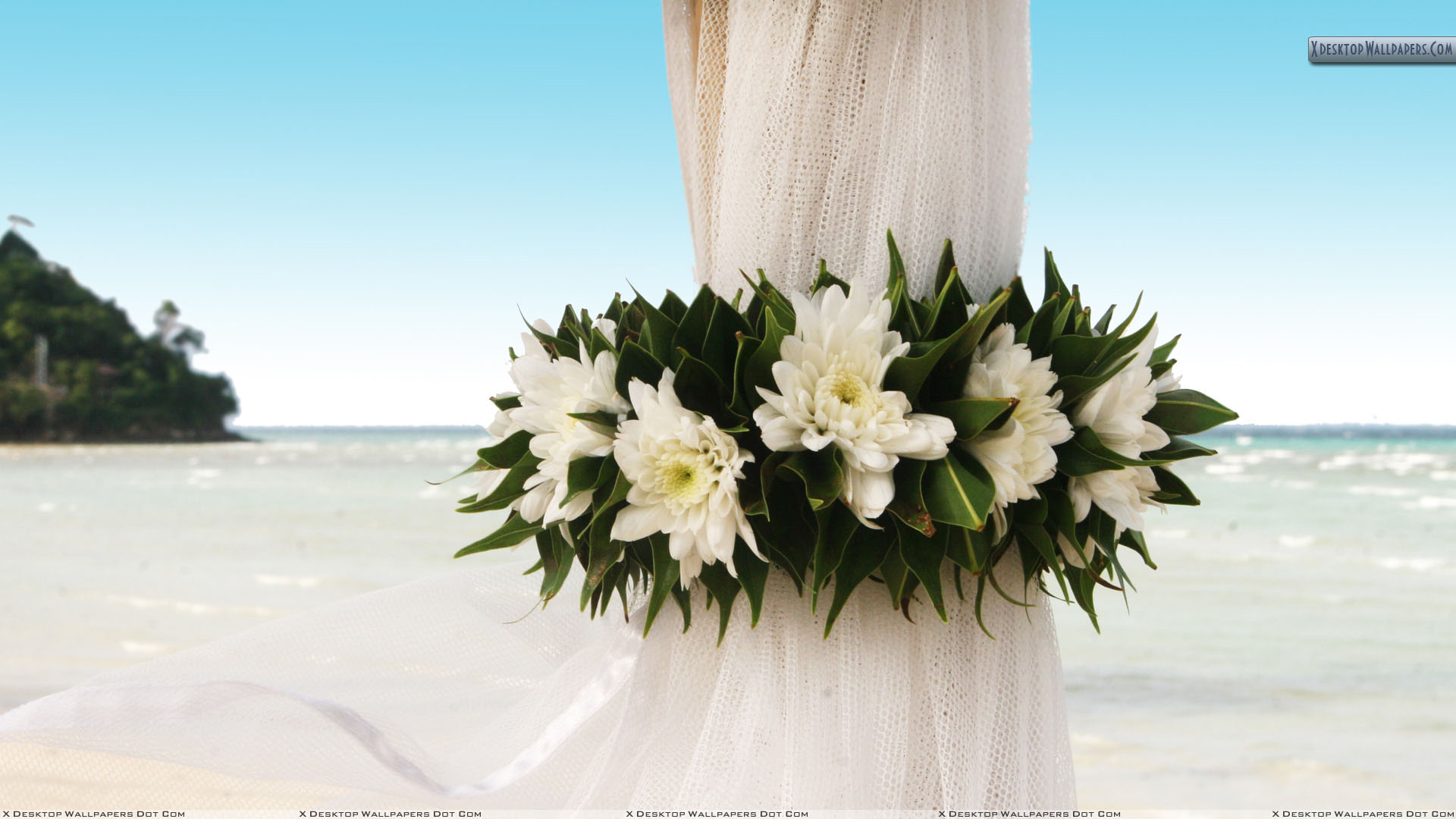 Wedding-Flowers-On-Curtains-Near-Beach.jpg