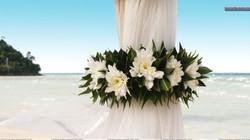 Wedding-Flowers-On-Curtains-Near-Beach.jpg
