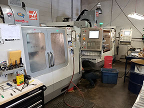 Maks has 2 Haas VF2's with 4 axis rotaries pumping out parts