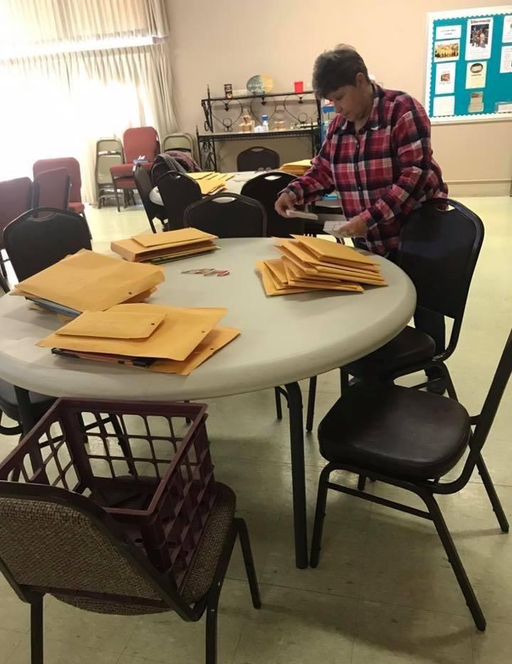 Jodie checking packages.jpg