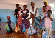 Mama Bakhita kids w: puppets 2005.jpg