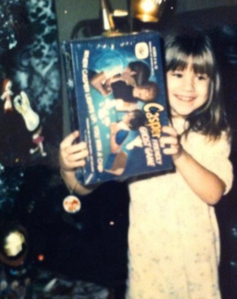 Suzanne, as a child, showing off her sweet Casper game!