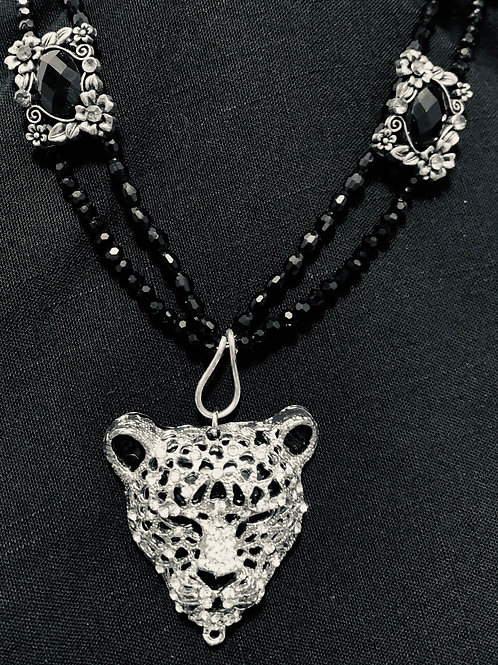 Black Crystals Hold Silver Leopard with Crystals