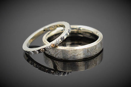 White Gold Wedding Bands - her with 19 diamonds in a variety of colors, his in mokume gane