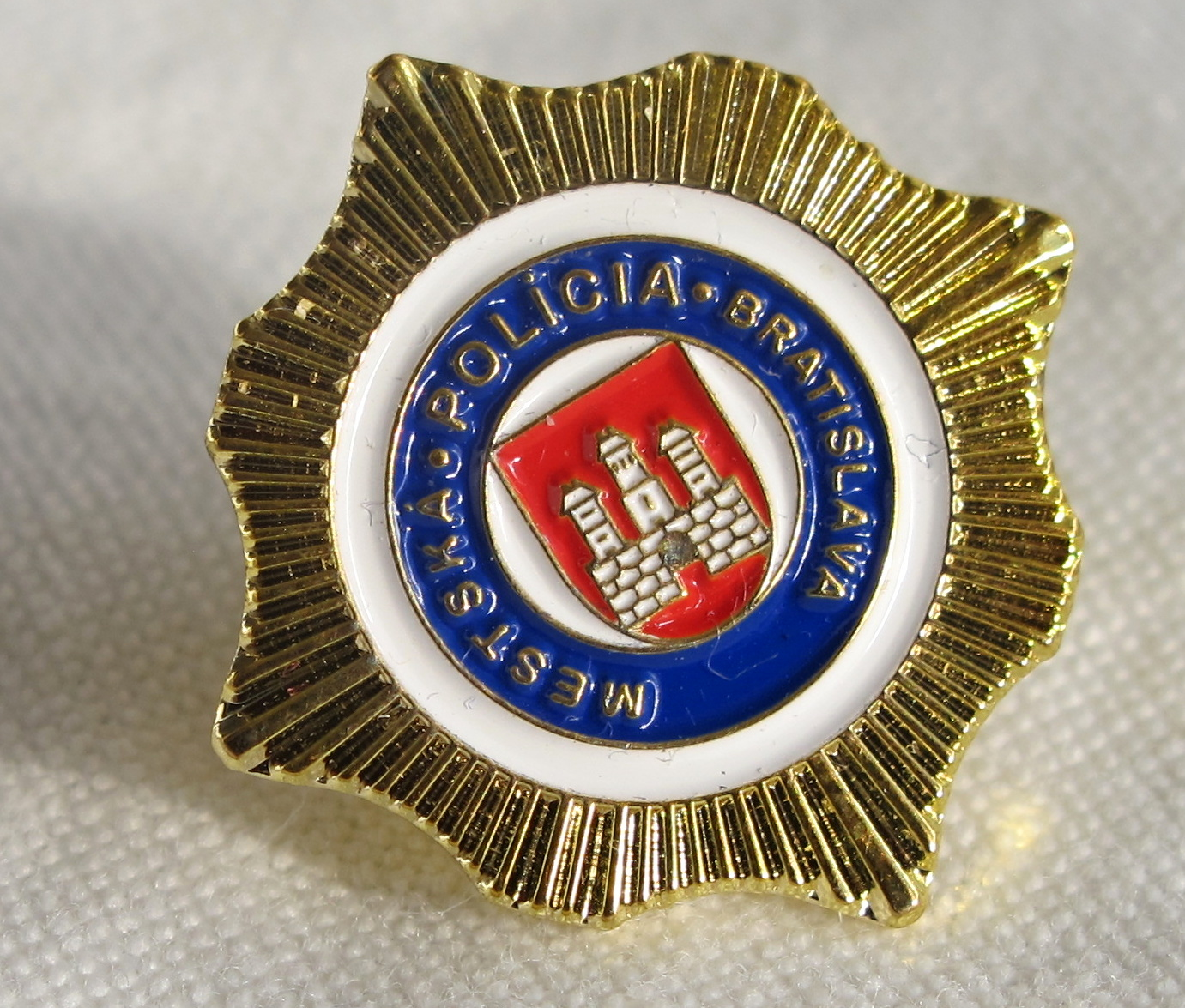 Metal badge with screw