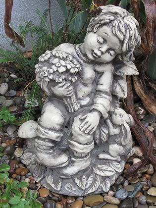 Sebastian; Junge; sitzend mit Hase; Vidroflor; Steinguss; 1205-B; 1210-B; 1201-B; Gartenfigur; Blumenstrauß