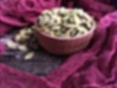 pumpkin seeds in a wooden spot.jpgGreen