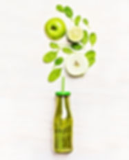 Green smoothie drink in bottle with stra