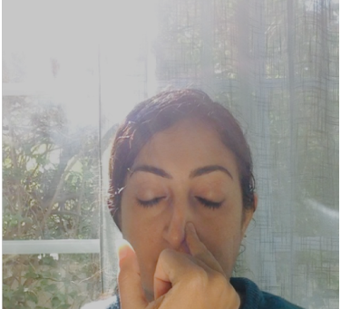 Nadi Shodhana Pranayama: Alternate Nostril Breathing.