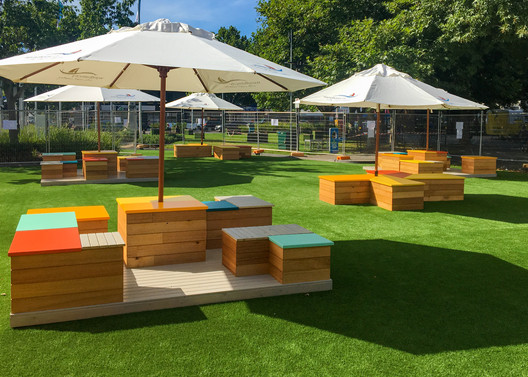 Pop-Up Picnic Seating and Umbrellas in a Park