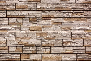 Brown and tan concrete veneer stone wall