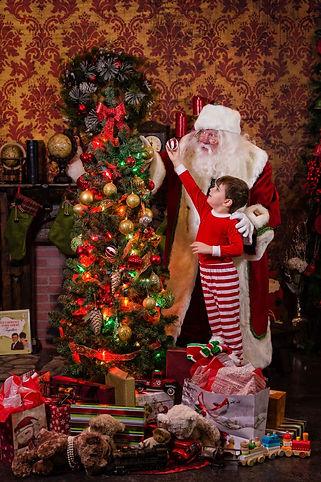 Santa Claus DFW decorating the Christmas Tree