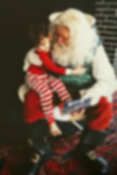 Santa Claus DFW get hug from Stevie