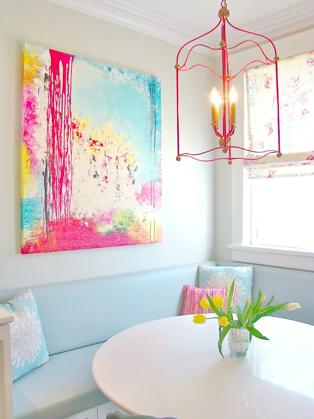 A bright and cheerful painting in a kitchen eating area