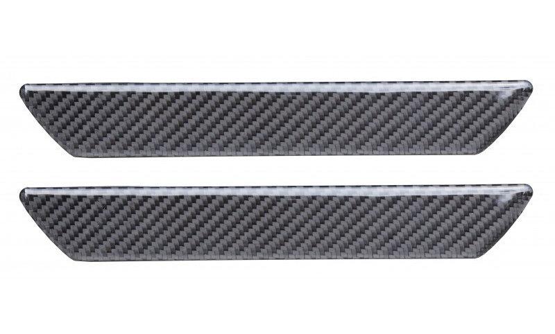 Battitacco adesivi in fibra di carbonio