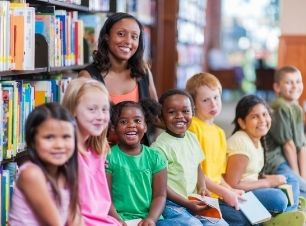 Kids in library smiling.jpg