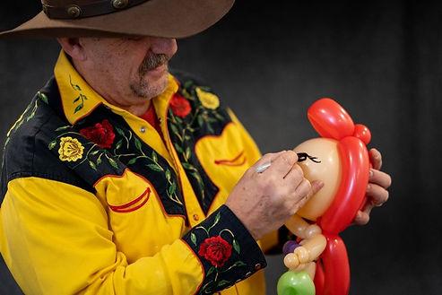 Arizona Rick with mermaid balloon animal.