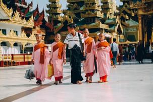Buddhist Monk Apprentices walk the Shwedagon Pagoda