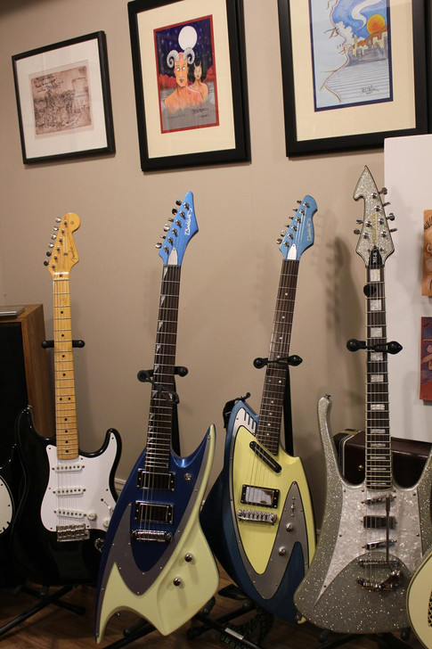 A Fender, a couple of Backlunds and a Musicvox with Bill Nelson original artwork
