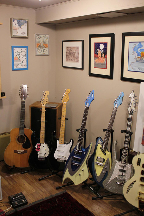 Some of David's guitars surrounded by Bill's artwork