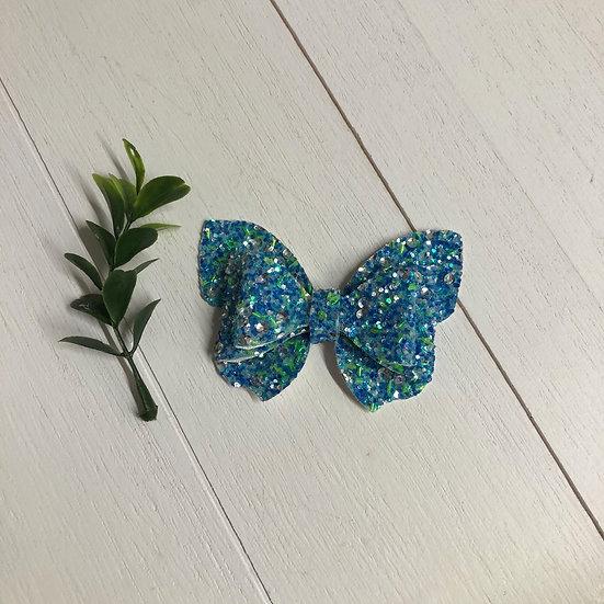 Boucle papillon bleu