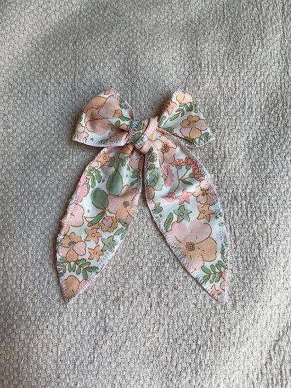 boucle ruban fleurs corail