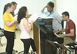 """Julie Galorenzo, Brian Michael Flanagan, Katie Babb, and Yolanda Batts rehearse """"Stage Fright"""" with musical director Jeffrey Campos for the 2007 FringeNYC production of Show Choir! - The Musical"""