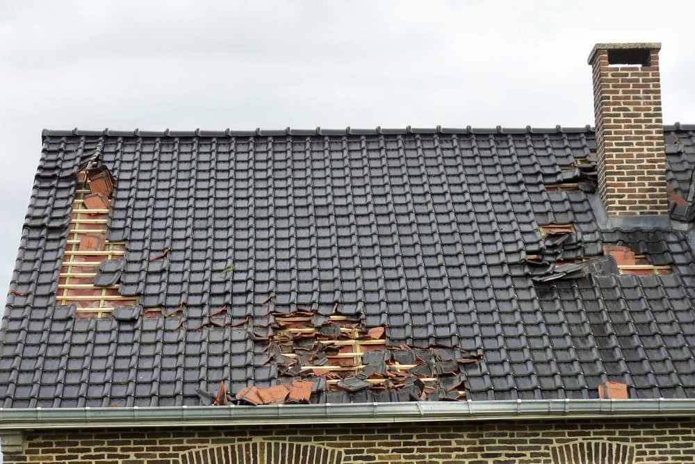 storm damages roof tiles