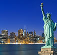 Canva - Manhattan at night and Statue of